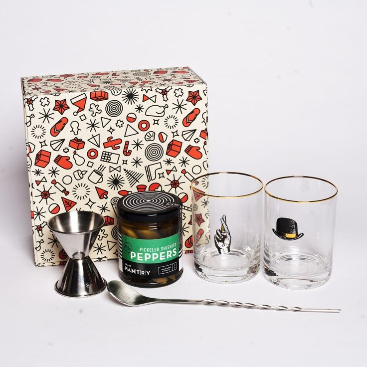 Holiday Happy Hour Gift Set.  Looking for the perfect Secret Santa gift for the cocktail lover? Look no further. Our Holiday Happy Hour Gift Pack will delight any giftee because it's beginning to feel a lot like cocktails.  Includes: - 2 Double Old Fashioned Cocktail Glasses (Fingers Crossed + Top Hat) - Jigger - Cocktail Stir Stick - Pickled Garden Chillies (320g)