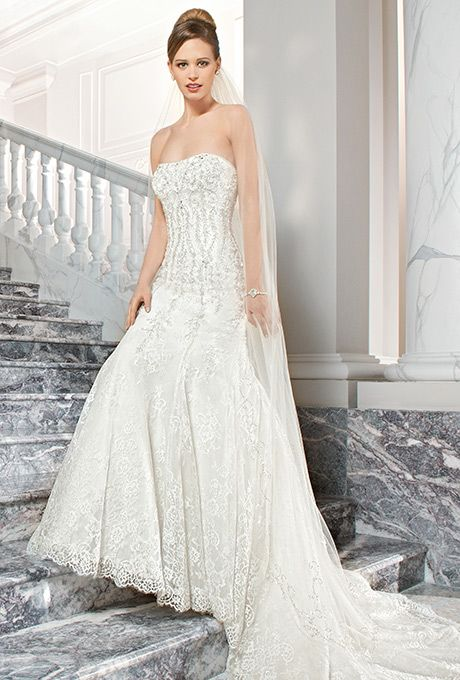 Brides: Demetrios Couture. This sophisticated form fitting beaded lace gown features intricate beaded embroidery on the bodice, low v back and a chapel train.