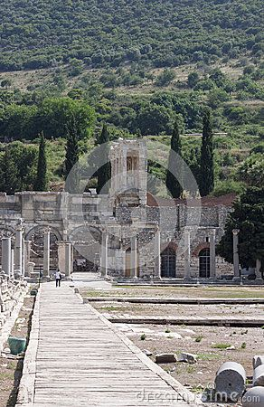 A tourist is visiting the ancient greek, later roman, city of Ephesus in the actual Turkey