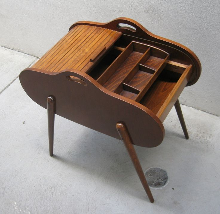 My mom had one of these sewing boxes which I was fascinated with when I was little!