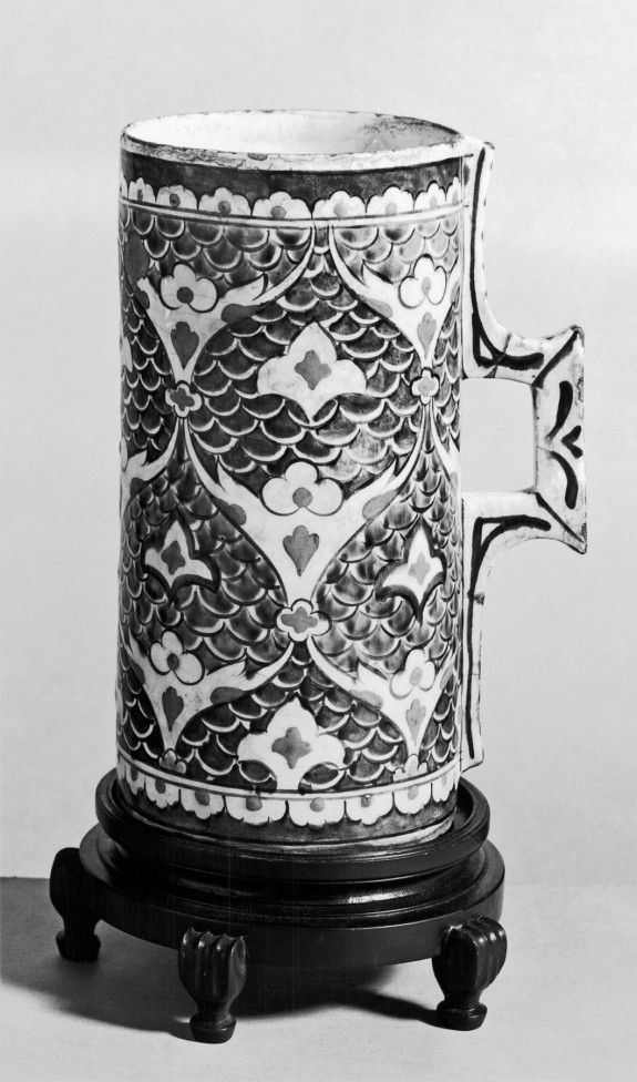 Tankard This blue, green, and black polychrome tankard is an example of Iznik Rhodian ware and is decorated with arabesques and trefoils.late 16th century (Early Modern)
