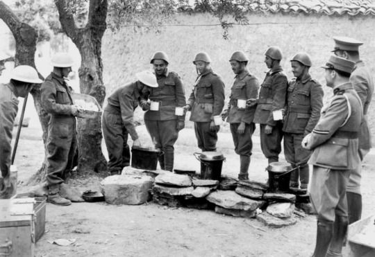 British artillerymen (left) hand out tea and bread to Greek soldiers during the Battle of Crete as a Greek officer and a policemen watch on the right. The Greek armed forces suffered from a shortage of modern weapons and motor transport. However, the mountainous frontier with Albania was ideal for defensive fighting and proved too much for the Fascist Italian forces which invaded the country on 28 October 1940. The initially outnumbered Greek forces were able not only to contain the…
