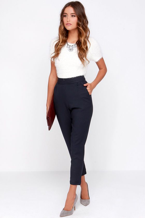 As Seen On Tiffany of Tuolomee blog! Fashion fads come and go, but your love for a classic staple like the Trouser We Go Navy Blue High-Waisted Pants, will never fade! These high-waisted trousers, in a soft woven-poly blend, have a banded waist that tops a series of delicate pleats that fall into diagonal slit pockets. The slightly tapered legs keep this look chic and clean. Hidden side zipper with clasp. Unlined. 97% Polyester, 3% Spandex. Hand Wash Cold.