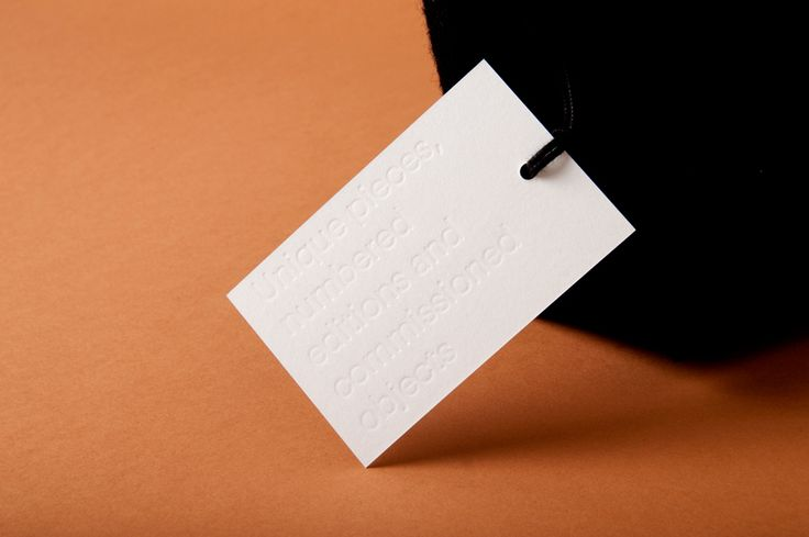 The Best of BP&O – Blind Emboss: Tag with blind embossed sans-serif typography designed by P.A.R for Numbered by Martín Azúa