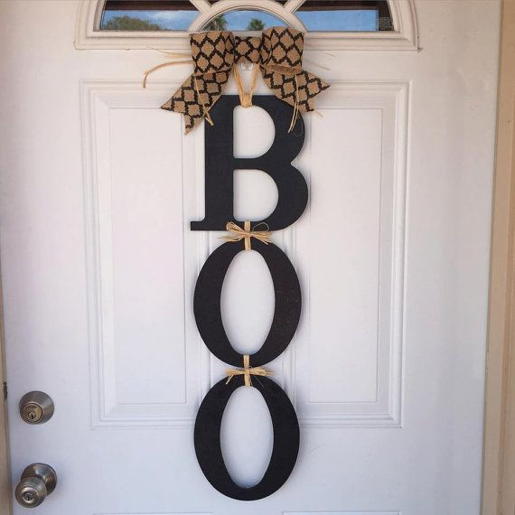 This adorable, yet simple, BOO Door Hanger is perfect for any non-spooky décor for Halloween. These are 3 wooden letters held together with