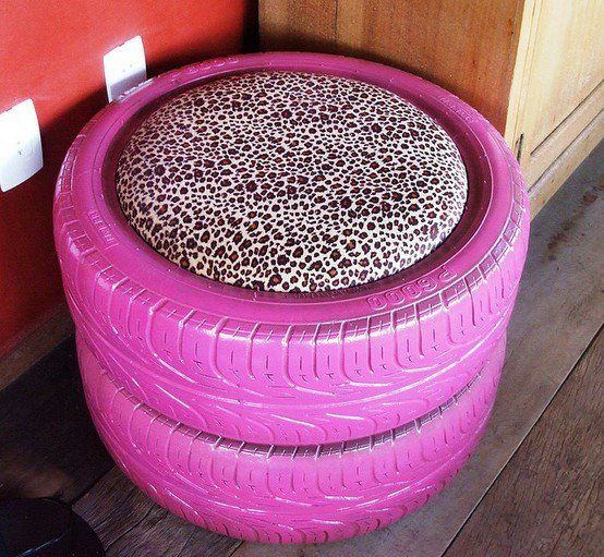 Paint those old tires up....and create a kitty pillow or even hard top it for a side table.  :)