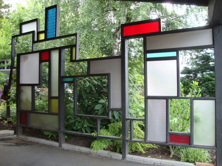 Cool idea ~ outdoor stain glass privacy screen