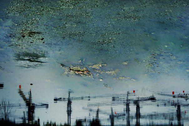 Red Flags Flying on Skylines Cranes: Urban Amber 2005  100x150cm, 60x90cm C-Print