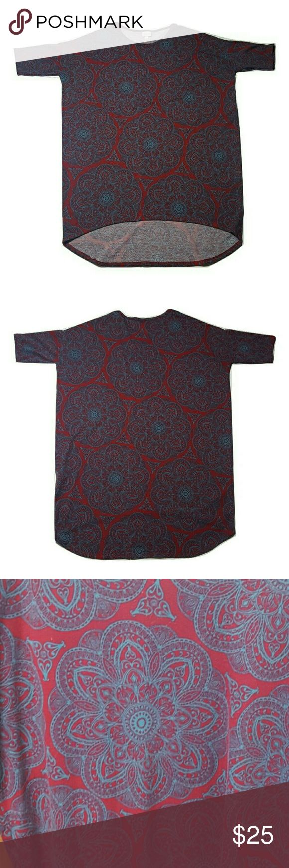 Lularoe Shirt. EUC. Not exactly sure if it's a Classic Tee or an Irma. Cute print! Size M- but as you can tell, it is rather large. High low feature goes great with a pair of leggings!! LuLaRoe Tops