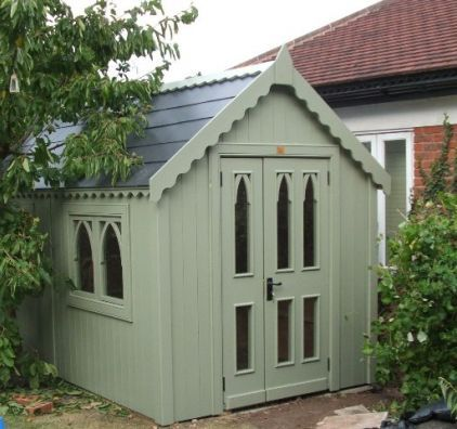 Like this neo-gothic looking shed. The regular door with side panel opening is different as is the green color.