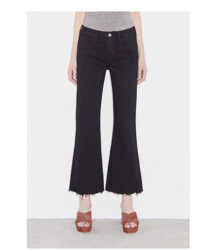 Mih Jeans Lou Cropped Flare in Black: The high rise Lou jean from Mih Jeans has a modernised take on a 70s style. The free-spirited super flare that hovers above the ankle mixed with a fitted feminine feel, creates the perfect jean. The raw hems lends a handmade attitude and distressed edge to a traditional jean.