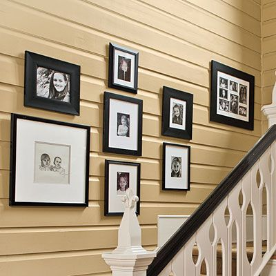 """Family Portraits...Connect the past and present by framing and matting old photographs and portraits in a fresh way. """"Clean them up, blow them up—do whatever you need to do—and then put them in a simple black or white frame,"""" says Phoebe. """"Black looks modern, but white with a white mat also looks great.""""    Steer clear of posed-looking family portraits, though. """"Instead, take candid, casual pictures, and collect them as a nice assortment on the wall,"""" she says...Decor Tips, Blank Wall, Decor Ideas, Families Pictures, Families Photos, Be Creative, Difference Style, Photos Arrangements, Easy Decor"""