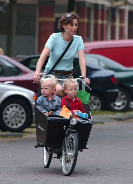 Typically Dutch: Princess Marilene (wife of Prince Maurits) just like any other Amsterdam mum pedaling the 'bakfiets'. #greetingsfromnl