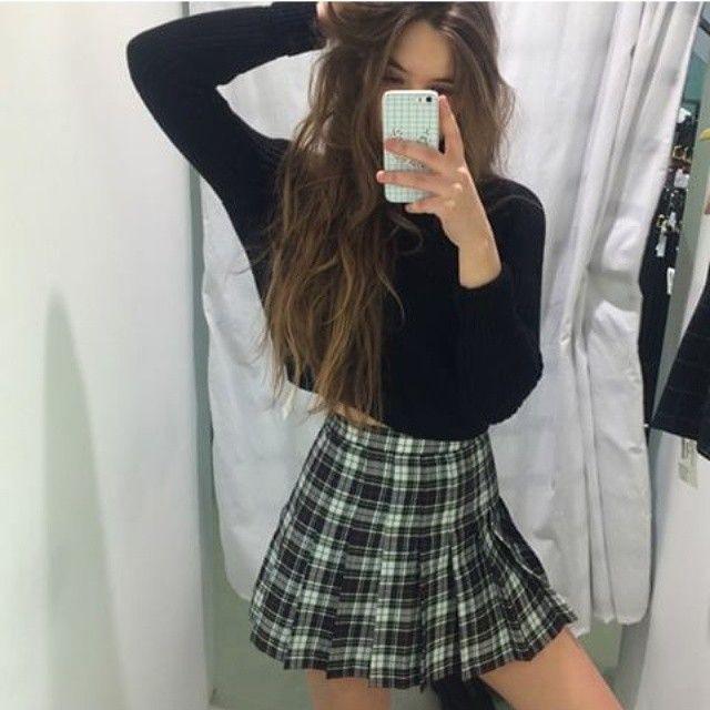 Plaid schoolgirl skirt and long sleeved crop top