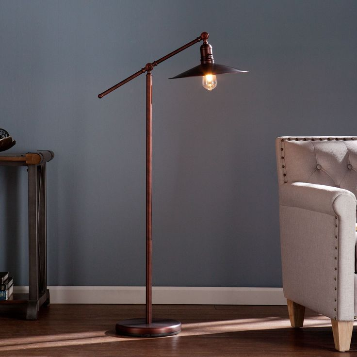 Add a touch of industrial chic to your home with this trendy floor lamp. The…  http://www.justleds.co.za