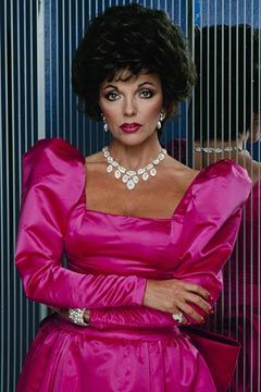 The exaggerated large shoulder pads look were also incorporated into more glamourous evening gowns and casual wear also