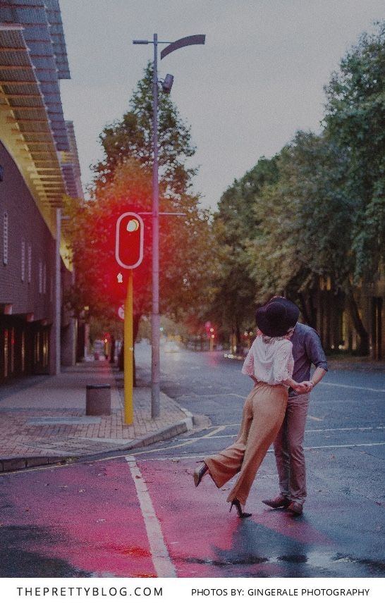 Dancing in the Rain: A Johannesburg Engagement Shoot in Braamfontein | Photograph by GingerAle Photography