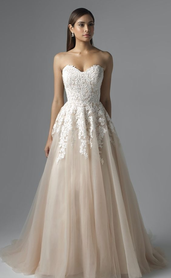 Sophisticated lace bodice blush tulle skirt ballgown wedding dress; Featured Dress: Mia Solano