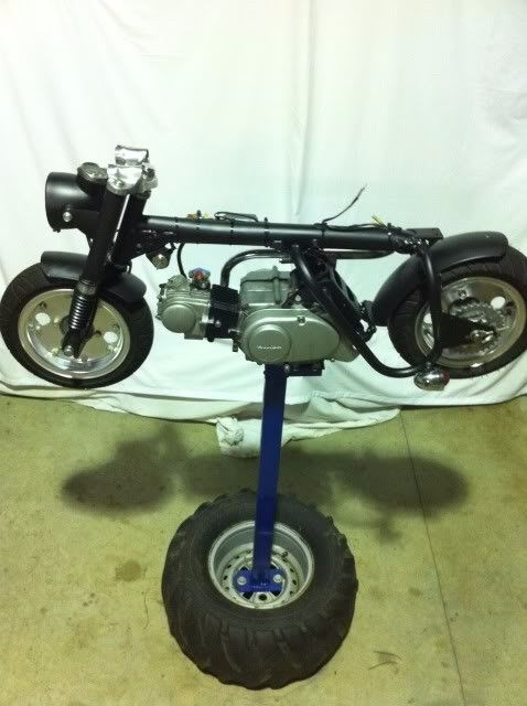 Mini Bike Stand by blackattack -- Homemade mini bike stand constructed from tubing, steel plate, a surplus ATV wheel, nuts, and bolts. http://www.homemadetools.net/homemade-mini-bike-stand