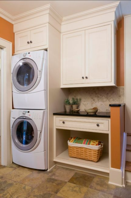 Small laundry room? Inspiration to maximize your space and have a functional laundry room/mudroom. Stacked washer/dryer with cabinets above. Love that molding! | Tiny Homes