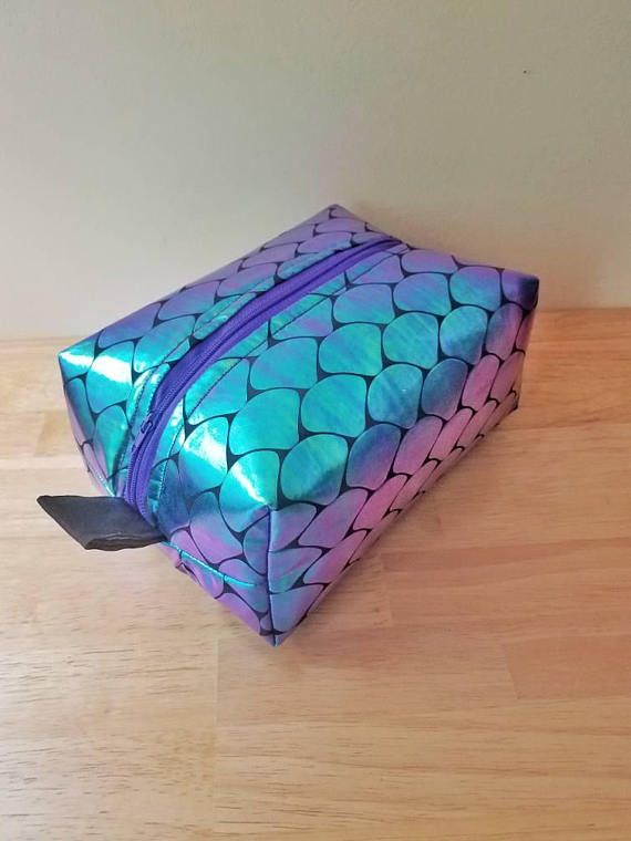 Check out this item in my Etsy shop https://www.etsy.com/listing/494053134/iridescent-fish-scale-boxy-make-up-bag