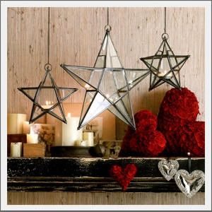 Star lantern. Ready. Set. Glow. Our beautiful glass and iron lanterns may be hung indoors or under an outdoor covered porch. The glass panes with iron framework form these handsome star shaped lanterns. Each lantern holds a single tealight candle and hangs from a chain. Beach Christmas | handsome guys picture handsome and hung
