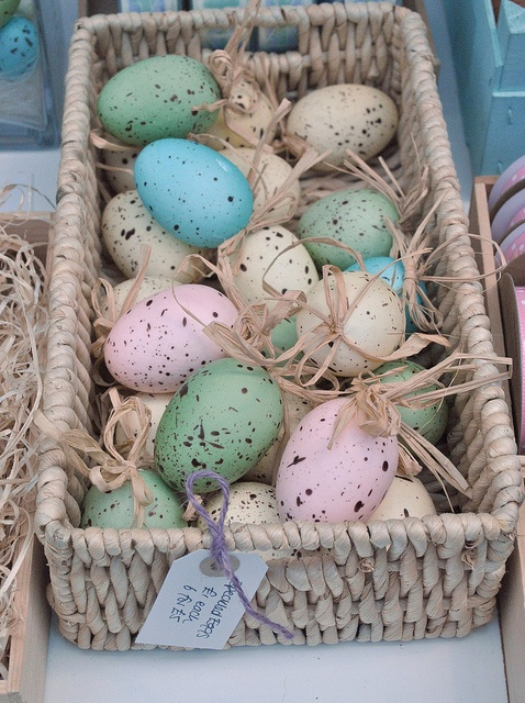 Basket of pastel coloured eggs...