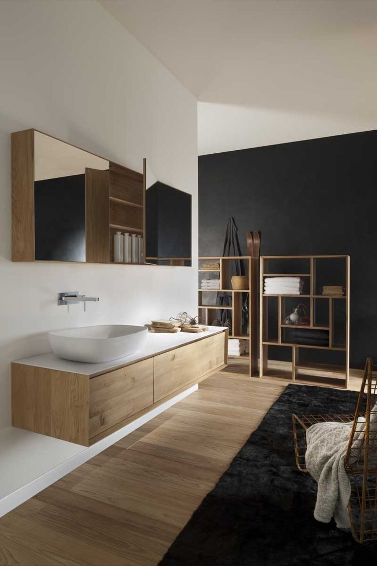 clever use of black feature wall, black shaving cabinet instead of mirror and blonde timbers