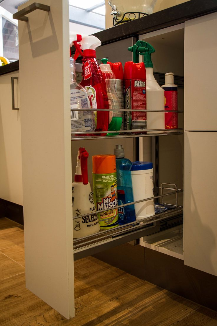 Small pull-out pantry. Cleaning cupboard. Modern kitchen. www.thekitchendesigncentre.com.au