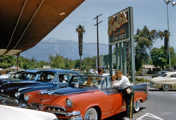 """At Bob's (""""Home of the Big Boy"""") in a 1956 Dodge Custom Royal convertible in the very mid-Fifties color scheme of coral and black Custom Royal."""