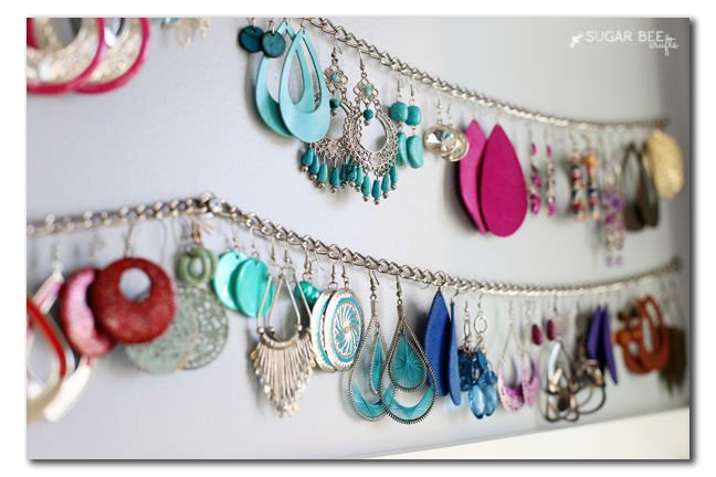 Hang a chain between two nails on your closet wall. Then, hook earrings into the loops of the chain for easy hanging. You can also use a chain collar or leash from your dollar store. Learn more about it at Sugar Bee Crafts.