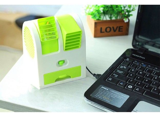 A mini USB-powered swamp cooler ($14) so you can make temperatures tolerable near your computer.