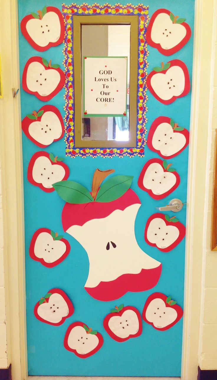 "Fall Apple Door. Children made apples using construction paper and black beans for seeds then, I added a large ""eaten"" apple. Title is, ""God loves us to our core!"""