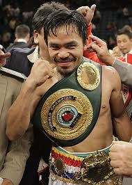 """THIS GUY IN THIS PHOTO IS MY FAVORITE FIGHTER AND BOXER OF ALL TIME AND HE IS A INSPIRATION TO ME WHEN IT COMES TO FIGHTING BECAUSE IF I WANTED TO BE LIKE SOMEONE WHO IS NOT SCARED OF NOBODY IN THAT RING AND IS JUST SOMEONE WHO IS VERY RELIGIOUS AND PUTS GOD ABOVE FIRST THAT MAN IS MANNY """"PACMAN"""" PACQUIAO!! THIS GUY IS WELL DESERVING OF BEEN IN THIS BOARD!!"""
