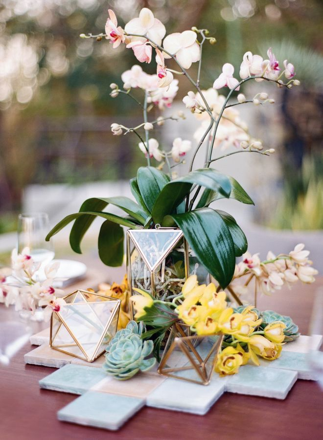 Tropical centerpiece: http://www.stylemepretty.com/little-black-book-blog/2016/05/24/pretty-plates-two-piece-wedding-dress-tropical-styled-shoot/ | Photography: Audra Wrisley - http://audrawrisley.com/