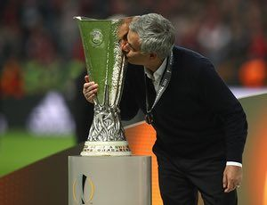 A kiss for Manchester United manager Jose Mourinho's fourth European trophy.