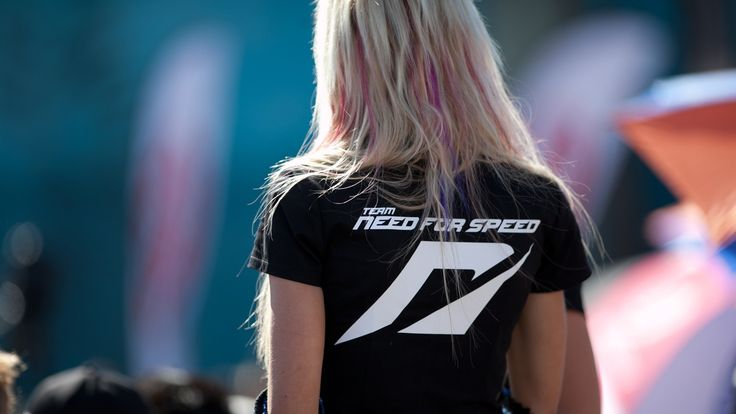 1920x1080 Wallpaper nfs, need for speed, female, blonde, t-shirt, back, sunlight, print