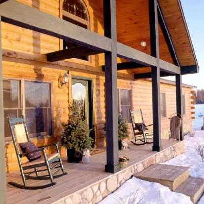 Log home with large porch overhang and black square porch for How big is a square of siding