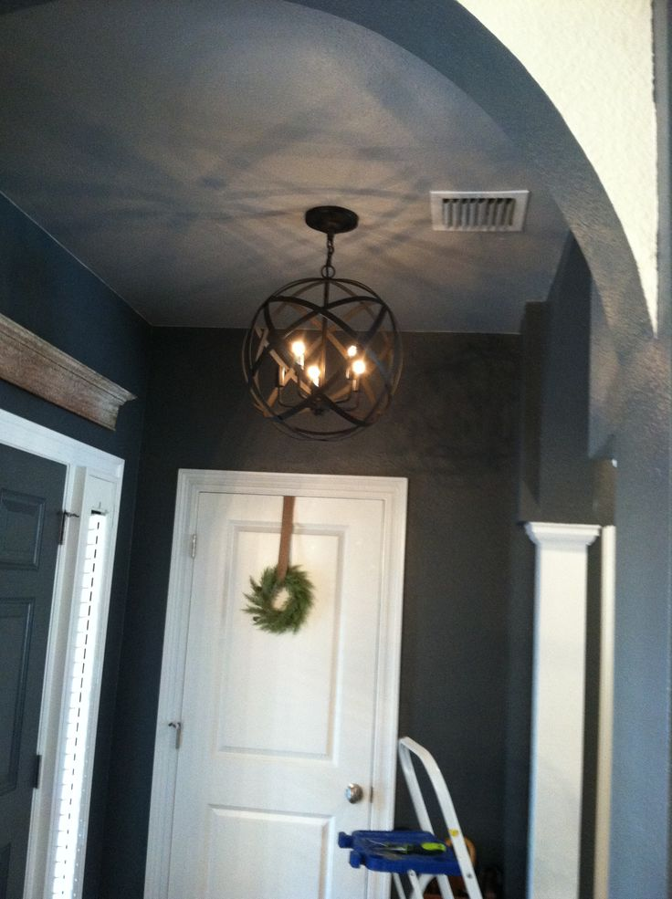 Orb light fixture in entryway. Thanks World Market!