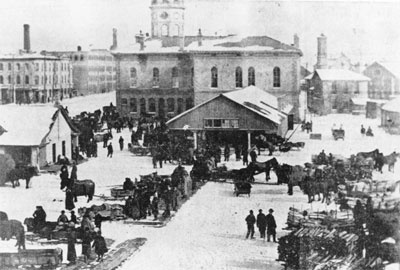 Carden Street was a thriving business area and goods were traded and sold in the market next to City Hall.    A wing to the south-west was added to provide a concert hall on the second floor and additional market space below.    Every three years, the wing hosted the Ontario Winter Fair as the annual event moved between Toronto, Guelph and Woodstock.