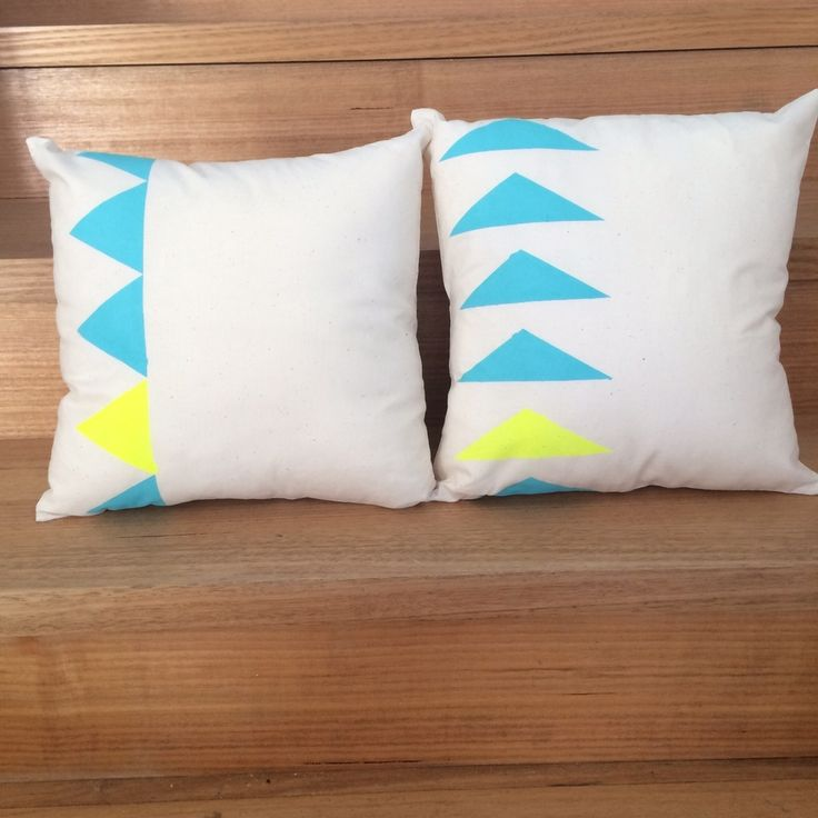 These cushion covers are hand painted and sewn from cotton fabric.  They are sewn as a slip style pillow with 2 buttons to keep it neatly closed. With a neutral background colour and vibrant teal and neon yellow Aztec style painted patterns, they are perfect to add some colour to any bedroom or lounge.Listing price is for one cushion cover only. Three options available as shown in the images. The square cushion covers fit an insert of 35cm x 35cm.  The rectangle cushion cove...