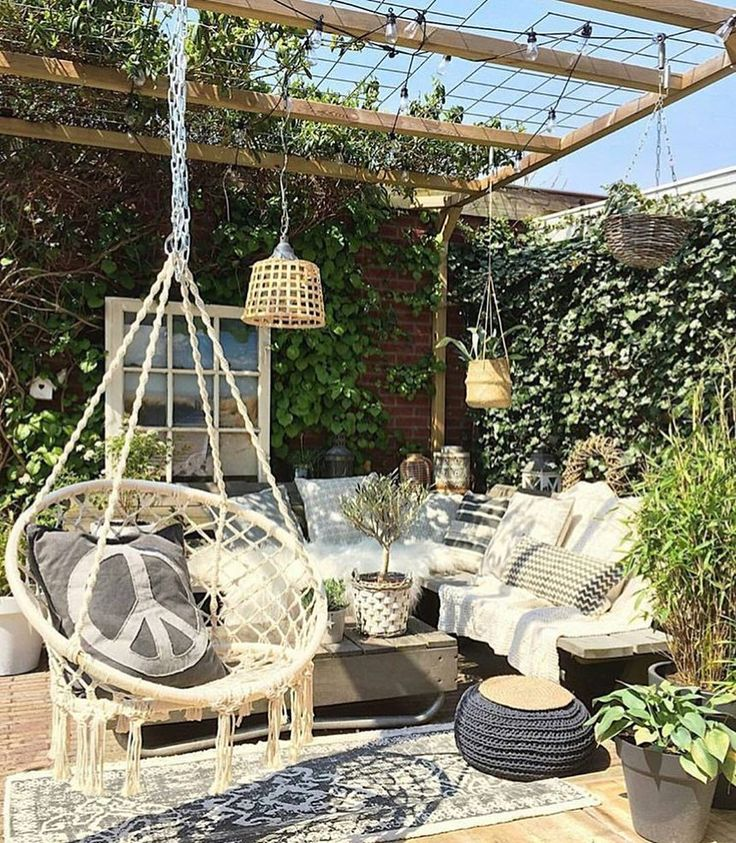 It feels amazing in London Town today! I mean..now it feels like spring..near enough summer matter of fact. This garden is how I want to spend every time I get when it's finally summer! Love love love this @thearmanihouse #love #adore #swoon #garden #outdoors #green #furniture #wicker #poof #bohovibes #hangingchairs #rug #lights #envy #goals #dreamingofsummer #thejungalow #wild #home by velvetmusings