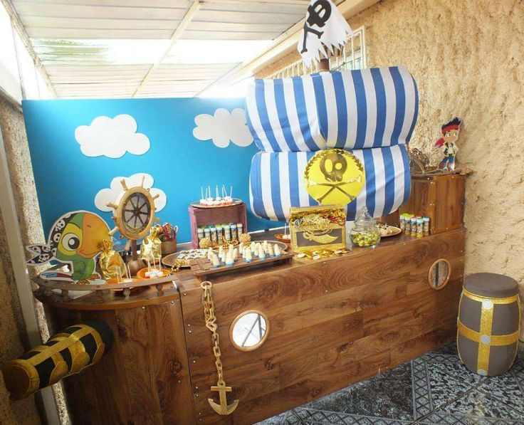 Pirate ship dessert table at a Jake and the Neverland Pirates boy birthday party!  See more party planning ideas at CatchMyParty.com!
