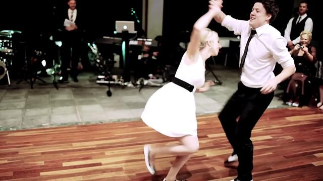 """Ryan and Frankie van Horn kick off their wedding reception with a perfectly classy — and perfectly sassy — swing dance performance to Benny Goodman's """"Sing Sing Sing."""""""