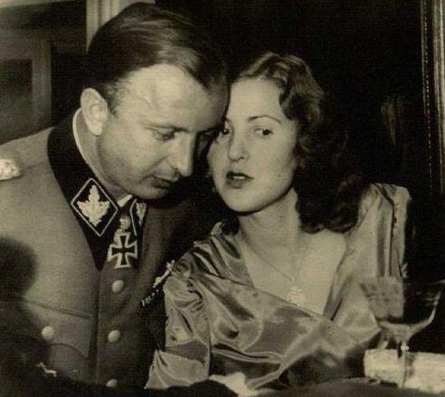 SS-Gruppenfuhrer (Obergruppenfuhrer, Waffen-SS) Hermann Fegelein and Margarete (Gretl) Braun (sister of Eva) enjoy an intimate moment, 1944....