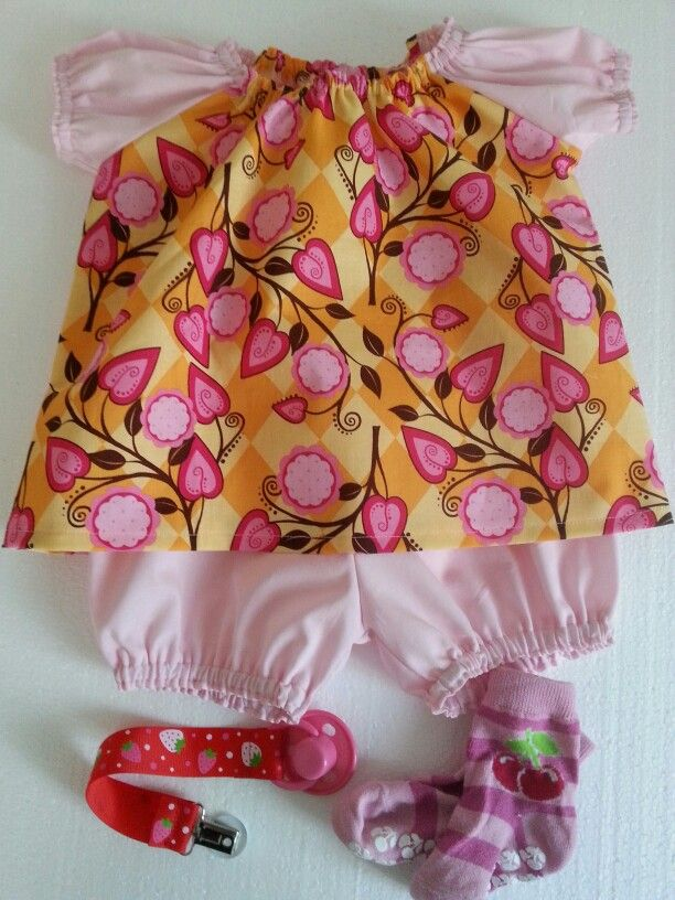 Dress for a babygirl with matching bloomers.