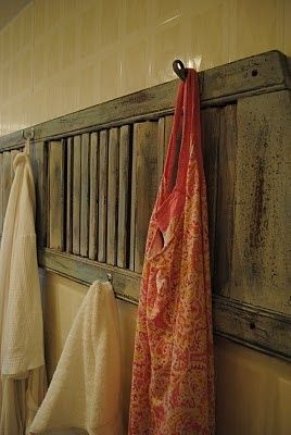 old shutter with hooks for hanging towels