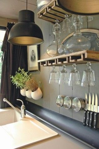 Chic Kitchen. Love this idea for how to display & store glassware, knives, misc. & my favorite small containers to grow herbs right above the kitchen sink!Cuisine organisée