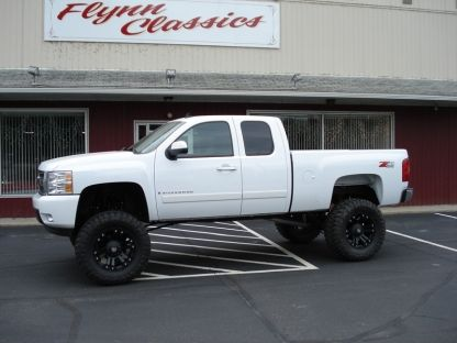 lifted full size Chevy trucks
