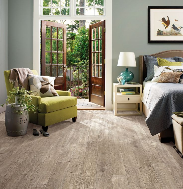 Inspiring Bedroom Design Using Light Oak Shaw Laminate Flooring Plus Green Armchair And Nightstand
